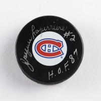 """Jacques Laperriere Signed Canadiens Logo Hockey Puck Inscribed """"H.O.F. 87"""" (COJO COA) at PristineAuction.com"""