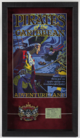 "Disneyland ""Pirates of the Caribbean"" 14.5x25.5 Custom Framed Print with Pirates of the Caribbean Ceramic Emblem & Vintage Disneyland Ride Ticket at PristineAuction.com"