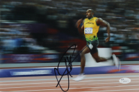 Usain Bolt Signed Team Jamaica 8x12 Photo (JSA COA) (See Description) at PristineAuction.com