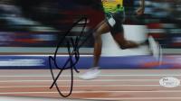 Usain Bolt Signed Team Jamaica 8x12 Photo (JSA COA) (See Description) at PristineAuction.com