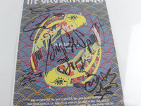 """The Smashing Pumpkins"" 12x18 Poster Print Band-Signed By (6) With Billy Corgan, James Iha, Jimmy Chamberlin, Jeff Schroeder, Katie Cole (Beckett LOA) at PristineAuction.com"