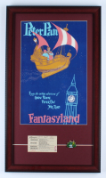 "Disneyland Fantasyland's ""Peter Pan"" 15x26 Custom Framed Print Display with Vintage 1960s ""C"" Ride Adult Ticket & Peter Pan Lapel Pin at PristineAuction.com"