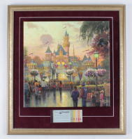 "Thomas Kinkade 50th Anniversary ""Disneyland"" 20.5x22.5 Custom Framed Canvas on Wood Display with Vintage Ticket Booklet at PristineAuction.com"