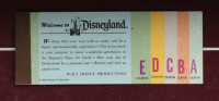 """Thomas Kinkade 50th Anniversary """"Disneyland"""" 20.5x22.5 Custom Framed Canvas on Wood Display with Vintage Ticket Booklet at PristineAuction.com"""