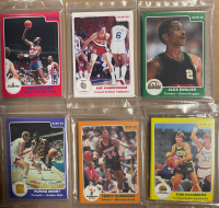 Complete Set of (24) 1984-85 STAR Basketball Card Unopened Team Bags with 1984-85 Star #101 Michael Jordan XRC at PristineAuction.com
