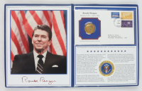 Ronald Reagan Memorial Commemorative Coin, Photo and Postcard Set In Binder at PristineAuction.com