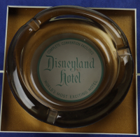 """Disneyland's """"Disneyland Hotel"""" 15x26 Print Display with Vintage Match Book, Ash Tray & Employee Lapel Pin at PristineAuction.com"""