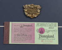 """Disneyland's """"Pirates of the Caribbean"""" 15x26 Print Display with Vintage Ride Pin, Vintage Postcard & Vintage Disney Coupon Book at PristineAuction.com"""