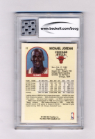 Michael Jordan 1990 Hoops 100 Superstars #12 With Game-Used Jersey Piece (BCCG 10) at PristineAuction.com