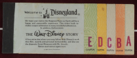 """Thomas Kinkade 50th Anniversary """"Disneyland"""" 20x21.5 Custom Framed Canvas on Wood Display with Vintage Ticket Booklet (See Description) at PristineAuction.com"""