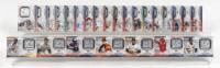 Set of (25) 2021 Topps 70th Anniversary Commemorative Logo Patches Baseball Cards with Hank Aaron #70LP-HA, Cal Ripken Jr. #70LP-CR, Ken Griffey Jr. #70LP-KG, Mike Trout #70LP-MT, Derek Jeter #70LP-DJ at PristineAuction.com