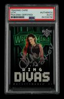 "Lita Signed 2004 Fleer WWE WrestleMania XX #60 RD Inscribed ""7-24-04"" (PSA Encapsulated) at PristineAuction.com"