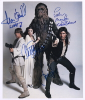 """Star Wars 12x14 Photo Signed by (4) with Harrison Ford, Carrie Fisher, Mark Hamill & Peter Mayhew Inscribed """"Chewbacca"""" & """"Luke"""" (Beckett LOA) at PristineAuction.com"""