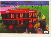 Usain Bolt Signed Team Jamaica 2008 Beijing Olympics 8x11 Print (JSA COA) (See Description) at PristineAuction.com