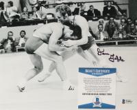 Dan Gable Signed 8x10 Photo (Beckett COA) (See Description) at PristineAuction.com