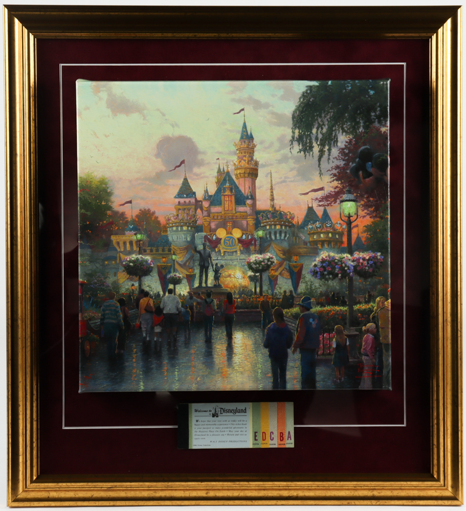 """Thomas Kinkade 50th Anniversary """"Disneyland"""" 20.5x23 Custom Framed Canvas Stretched on Wood Display with Vintage Ticket Booklet at PristineAuction.com"""