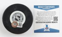 Reggie Leach Signed Bruins Logo Hockey Puck (Beckett COA) (See Description) at PristineAuction.com