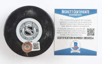 "Milt Schmidt Signed Bruins Logo Hockey Puck Inscribed ""H.O.F. 1961"" (Beckett COA) (See Description) at PristineAuction.com"