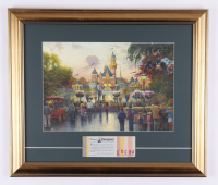 """Thomas Kinkade 50th Anniversary """"Disneyland"""" 16.5x19.5 Custom Framed Canvas with Vintage Ticket Booklet (See Description) at PristineAuction.com"""