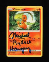 "Michael Haigney Signed Charmander 2018 Pokemon Dragon Majesty #1 Inscribed ""Psyduck"" (JSA COA) at PristineAuction.com"