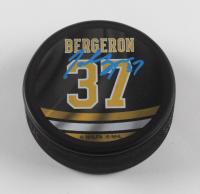 Patrice Bergeron Signed Bruins Logo Photo Hockey Puck (Bergeron COA) at PristineAuction.com