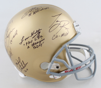 Notre Dame Fighting Irish Full-Size Helmet Team-Signed by (6) with Lou Holtz, Ricky Watters, Mike Stonebreaker with Multiple Inscriptions (PSA LOA) at PristineAuction.com