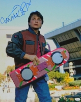 Michael J Fox Signed Back To The Future Part II Holding Hover Board 16x20 Photo at PristineAuction.com
