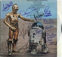 1977 Star Wars Album Signed by (9) with Harrison Ford, George Lucas, Mark Hamill, Carrie Fisher, David Prowse, Peter Mayhew, Kenny Baker, Anthony Daniels & John Williams (PSA LOA)