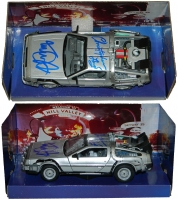 Michael J Fox & Christopher Lloyd Dual Signed Back To The Future Part II 1:24 Scale Die Cast Delorean Time Machine Car at PristineAuction.com
