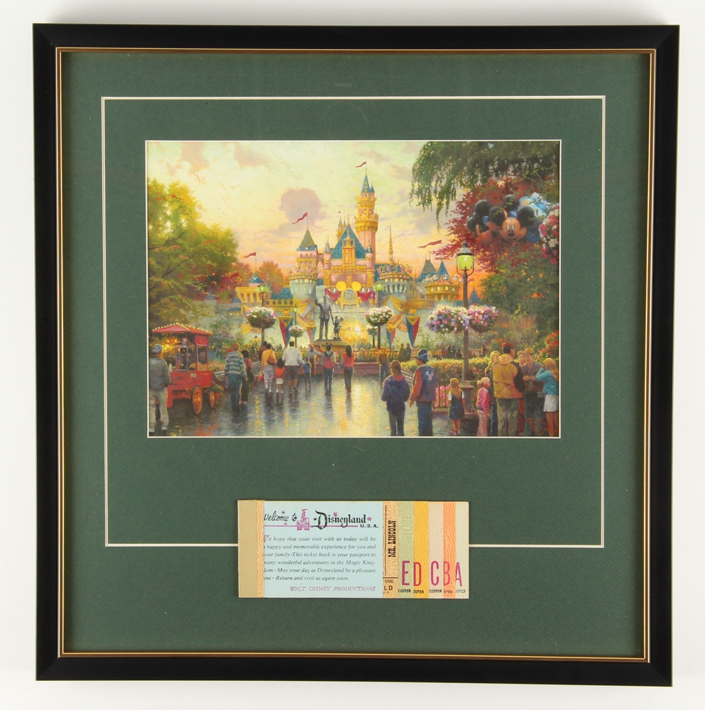 "Thomas Kinkade 50th Anniversary ""Disneyland"" 16.5"" x 17"" Custom Framed Lithograph Display with Full Vintage Ticket Book at PristineAuction.com"