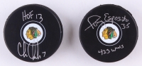 Lot of (2) Signed Blackhawks Logo Hockey Pucks with (1) Tony Esposito & (1) Chris Chelios (Schwartz COA) at PristineAuction.com