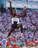 Carl Lewis Signed 8x10 Photo (Beckett COA)