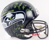 Seahawks Full-Size Helmet Signed by (25) with Russell Wilson, Marshawn Lynch, Doug Baldwin, Michael Bennett, Steve Largent, Matt Hasselbeck, Cortez Kennedy (JSA, PSA & Russell Wilson Holograms)