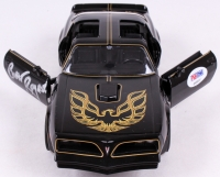 "Burt Reynolds Signed ""Smokey and the Bandit"" Limited Edition 1977 Pontiac Trans AM 1:24 Die-Cast Car (PSA COA) at PristineAuction.com"