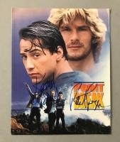 "Keanu Reeves & Patrick Swayze Signed ""Point Break"" Movie Folder (PSA LOA)"