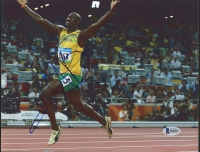 Usain Bolt Signed 8.5x11 Photo (Beckett COA)