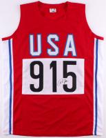 Carl Lewis Signed Team USA Olympic Jersey (JSA COA)